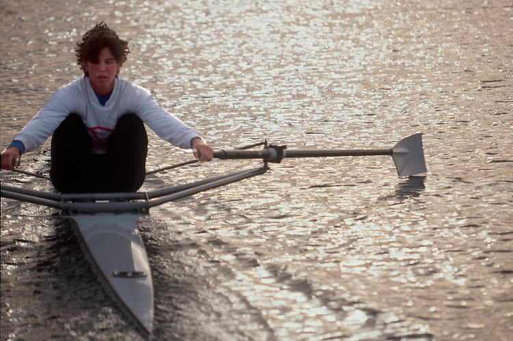 Rowing, Elite woman rower rowing a single racing shell at the catch, Sarah Jones, US National Rowing Team