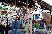 Arthellor and Carolyn (left) Scisney stand alongside Maybesomaybenot after the colt's stunning score in the Sanford.