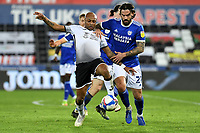 André Ayew of Swansea City vies for possession with Marlon Pack of Cardiff City during the Sky Bet Championship match between Swansea City and Cardiff City at the Liberty Stadium in Swansea, Wales, UK. Saturday 20 March 2021