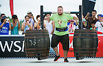 HAINAN ISLAND, CHINA - AUGUST 23:  Johannes Arsjo of Sweden competes at the Super Yoke event during the World's Strongest Man competition at Serenity Marina on August 23, 2013 in Hainan Island, China.  Photo by Victor Fraile