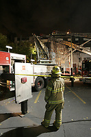 Montreal (Qc) CANADA -Oct 20 2009 - Montreal firemen at the scene of  a suspicious fire beside Cafe Cleopatre on Saint-Laurent Boulevard in Montreal red light district.<br /> Societe de Devellopement Angus ; A promoter want to evict the Cafe Cleopatre and demolish that  area to build a high rise building.