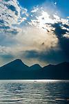 Italy, Veneto, Lake Garda, Brenzone sul Garda: mystic atmosphere at lake Garda, single fishing boat   Italien, Venetien, Gardasee, Brenzone sul Garda: mystische Lichtstimmung ueber dem Gardasee, ein einzelnes Fischerboot auf dem See