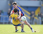 Eoin Cleary of Clare in action against David Murray of Roscommon during their National League game at Cusack Park. Photograph by John Kelly.
