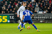Alfie Mawson of Swansea City faces up agents Riyad Mahrez of Leicester City  during the Premier League match between Swansea City and Leicester City at The Liberty Stadium, Swansea, Wales, UK. Sunday 12 February 2017