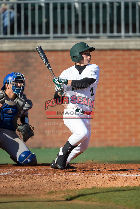Brad Elwood (2) of the Charlotte 49ers follows through on his swing against the Louisiana Tech Bulldogs at Hayes Stadium on March 28, 2015 in Charlotte, North Carolina.  The 49ers defeated the Bulldogs 9-5 in game two of a double header.  (Brian Westerholt/Four Seam Images)