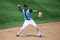 Syracuse Chiefs shortstop Trea Turner (4) throws to first during a game against the Pawtucket Red Sox on July 6, 2015 at NBT Bank Stadium in Syracuse, New York.  Syracuse defeated Pawtucket 3-2.  (Mike Janes/Four Seam Images)