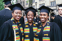 three graduates with kenti cloth, Yale, New Haven, CT