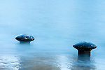 Bollard awash at mid tide on the Hawes pier.