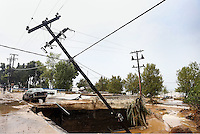 An electricity pole has almost collapsed when the road beneath it gave way in Nea Mihaniona