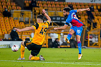 30th October 2020; Molineux Stadium, Wolverhampton, West Midlands, England; English Premier League Football, Wolverhampton Wanderers versus Crystal Palace; Andros Townsend of Crystal Palace takes a shot at goal but is blocked by Max Kilman of Wolverhampton Wanderers