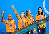 July 28, 2012: Netherlands 4x100m women's team wave at the fans at the conclusion of medal ceremony at the Aquatics Center on day one of 2012 Olympic Games in London, United Kingdom...