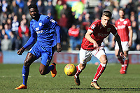 Bruno Ecuele Manga of Cardiff City chases the loose ball with Jamie Paterson of Bristol City during the Sky Bet Championship match between Cardiff City and Bristol City at the Cardiff City Stadium, Cardiff, Wales, UK. 25 February 2018