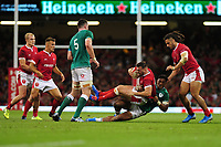 Owen Lane of Wales is tackled by Bundee Aki of Ireland during the under armour summer series 2019 match between Wales and Ireland at the Principality Stadium, Cardiff, Wales, UK. Saturday 31st August 2019