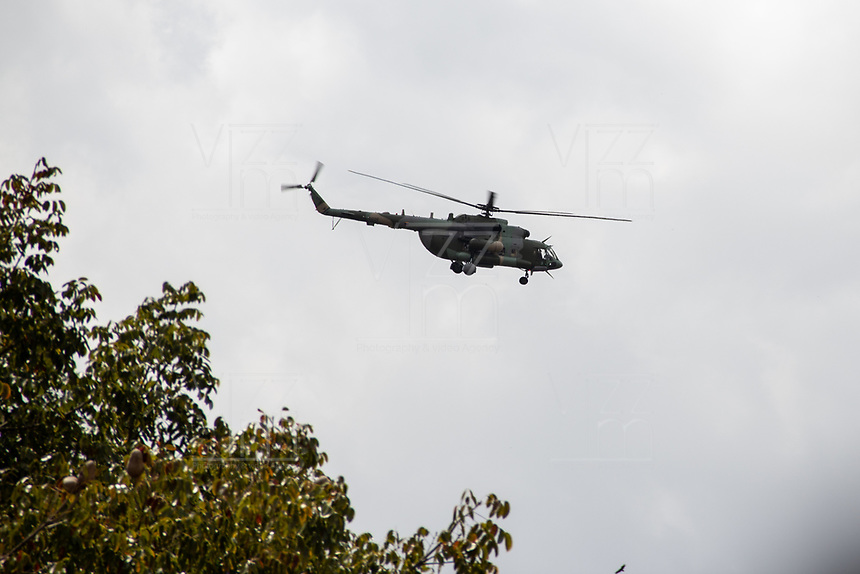 CARACAS - VENEZUELA, 04-03-2019:  Un helicopetro del regimen maduro sobreviual sobre Juan Guaidó, presidente interino de Venezuela, quien arribó a la nación a través del aeropuerto internacional de Maiquetía este 4 de marzo. En caravana se trasladó hasta la plaza Alfredo Sadel en Las Mercedes, donde cientos de manifestantes lo esperaban. Allí agradeció a su esposa por acompañarlo durante la travesía, y enfatizó que los militares no cumplieron la orden de detenerlo. Es una operación secreta Guaidó logró viajar de Panamá a Venezuela sin inconvenientes. / An helcopter of the Maduro's regimen fly over Juan Guaidó, interim president of Venezuela, who arrived to the nation through the Maiquetia international airport on March 4. In caravan, he moved to Alfredo Sadel Square in Las Mercedes, Caracas, where hundreds of protesters were waiting for him. There he thanked his wife for accompanying him during the crossing, and emphasized that the military did not comply with the order to arrest him. It is a secret operation. Guaido travel from Panama to Venezuela without problems. Photo: VizzorImage / Carolain Caraballo / Cont