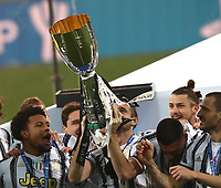 Football: Super Cup Final Juventus vs Napoli at Mapei Stadium in Reggio Emilia, on January 20,  2021.<br /> Juventus' captain Giorgio Chiellini (c) lifts the winners' trophy to celebrate with teammates after Juventus won 2-0  the Italian Super Cup Final match between Juventus and Napoli at Mapei Stadium in Reggio Emilia, on January 20,  2021.<br /> UPDATE IMAGES PRESS/Isabella Bonotto