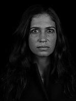 Portrait made using ultraviolet light of VII photographer Jessica Dimmock.
