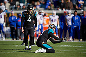 Jacksonville Jaguars Josh Lambo (4) lines up for a 44 yard field goal with two seconds left in the second quarter during an NFL Wild-Card football game against the Buffalo Bills, Sunday, January 7, 2018, in Jacksonville, Fla.  Brad Nortman (3) holds.  (Mike Janes Photography)