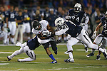Nevada defenders Nigel Haikins (23) and Dupree Roberts-Jordan (93) tackle Boise State's Jeremy McNichols (13) during the first half of an NCAA college football game in Reno, Nev, on Saturday, Oct. 4, 2014. Boise State won 51-46. (AP Photo/Cathleen Allison)