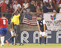 Yellow Card:  USMNT defender Michael Parkhurst (15) from Courtney Campbell. In CONCACAF Gold Cup Group Stage, the U.S. Men's National Team (USMNT) (blue/white) defeated Costa Rica (red/blue), 1-0, at Rentschler Field, East Hartford, CT on July 16, 2013.