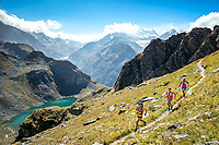 Trail running near Lac de Louvie, from Verbier, with a view of the Grand Combin, on day one of the Via Valais, a multi-day running tour connecting Verbier and Zermatt, Switzerland.