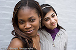 Education High School  senior students posing and having fun outside school building two female students posing together horizontal