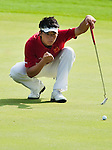 SHENZHEN, CHINA - OCTOBER 31: Xin-Jun Zhang of China lines up a puttduring the day three of Asian Amateur Championship at the Mission Hills Golf Club on October 31, 2009 in Shenzhen, Guangdong, China.  (Photo by Victor Fraile/The Power of Sport Images) *** Local Caption *** Xin-Jun Zhang