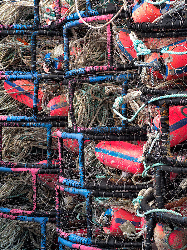 Colorful floats in crab pots stacked at Newport  Haebor. Oregon