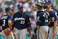 Milwaukee Brewers second baseman Rickie Weeks #23 talks with teammates Cesar Izturis #3 and Martin Maldonado #12 during a mound meeting in the Major League Baseball game against the Chicago White Sox on June 24, 2012 at US Cellular Field in Chicago, Illinois. The White Sox defeated the Brewers 1-0 in 10 innings. (Andrew Woolley/Four Seam Images).