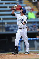 Asheville Tourists center fielder David Dahl #21 celebrates after homering during a game against the  Delmarva Shorebirds at McCormick Field on April 6, 2014 in Asheville, North Carolina. The Shorebirds defeated the Tourists 4-2. (Tony Farlow/Four Seam Images)