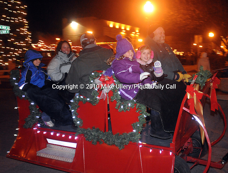 A horse-drawn Christmas sleigh makes its way down Main Street in Piqua on Friday night during the annual Christmas on the Green sponsored by Mainstreet Piqua.