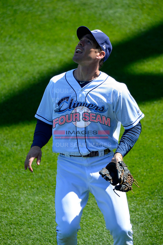 Columbus Clippers outfielder Matt Carson #25 tracks down a fly ball during a game against the Toledo Mudhens on April 22, 2013 at Huntington Park in Columbus, Ohio.  Columbus defeated Toledo 3-0.  (Mike Janes/Four Seam Images)