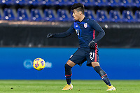 WIENER NEUSTADT, AUSTRIA - : Ulysses Llanez Jr #21 of the United States moves with the ball during a game between  at Stadion Wiener Neustadt on ,  in Wiener Neustadt, Austria.