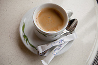Coffee at the Café de Paris in Casino Square is served with sugar packets that display the Société des Bains de Mer (SBM)'s logo, Monaco, 18 October 2013