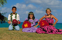 Hula students (haumana) with implements, uli uli and ipu