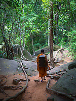 """A buddhist Monk returning from his pilgrimage to Kbal Spean (""""Bridge Head"""") is an Angkorian era archaeological site on the southwest slopes of the Kulen Hills to the northeast of Angkor in Siem Reap District, Siem Reap Province, Cambodia. It is situated along a 150m stretch of the Stung Kbal Spean River, 25 kilometres (16mi) from the main Angkor group of monuments, which lie downstream."""