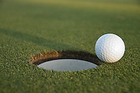 Golfball on lip of cup