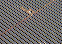 10/03/15<br /> <br /> A giant solar panel farm in Derbyshire has been targeted by criminals. 'Eco-friendly' thieves  struck twice walking-off with almost 100 solar panels from the 112 acre site being constructed by Solarcentury at Aston House Farm near Sudbury, Derbyshire. <br /> <br /> When the stolen panels are replaced and the site is switched on, the 20 megawatt solar panel farm will generate enough electricity to power 5,500 homes.<br /> <br /> Despite 24 hour security patrolling the 11 fields next to the A50 dual carriage way, Derbyshire Police Police are appealing for witnesses after a large amount of solar panels and plant equipment were stolen from land near Sudbury.<br /> Between 6pm on Tuesday, March 3 and 7am the next morning, thieves went onto fields off the A515 Lichfield Road and removed 14 solar panels.<br /> A total of 84 panels were stolen from another site in Lichfield Road between 6pm on Friday, February 27 and 11.30am the next day.<br /> The panels were 2ft by 3ft and, due to the quantity, would have required at least one vehicle to move from the location. A sit-on roller was stolen from a third site, also in Lichfield Road, between 6pm on Tuesday, January 13 and 7am the following day.<br /> <br /> <br /> <br /> <br /> <br /> <br /> <br /> All Rights Reserved: F Stop Press Ltd. +44(0)1335 418629   www.fstoppress.com.