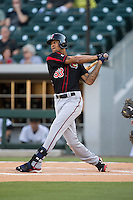 Byron Buxton (53) of the Rochester Red Wings follows through on his swing against the Charlotte Knights at BB&T BallPark on August 8, 2015 in Charlotte, North Carolina.  The Red Wings defeated the Knights 3-0.  (Brian Westerholt/Four Seam Images)
