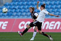 US's Kelley O'Hara fights for the ball with Germany's Anja Mittag during their Algarve Women's Cup soccer match at Algarve stadium in Faro, March 13, 2013.  .Paulo Cordeiro/ISI