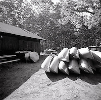 Canoes stacked on top of each other<br />