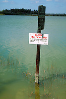 Sign warning of mercury content in fish caught in these waters.