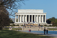 People visit the Lincoln Memorial on a spring day in Washington, DC.