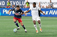 FOXBOROUGH, UNITED STATES - AUGUST 20: Matt Polster #8 of New England Revolution controls the ball as Sergio Santos #17 of Philadelphia Union comes in to tackle during a game between Philadelphia Union and New England Revolution at Gilette on August 20, 2020 in Foxborough, Massachusetts.