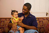 MR / Schenectady, NY. Father (22, African American) talks to his infant daughter (girl, 10 months, African American & Caucasian). MR: Dal7, Dal4. ID: AL-HD. © Ellen B. Senisi