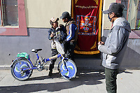 Two Tibetan teenagers intimidate a younger boy in a town on the Tibetan Plateau, in western China.