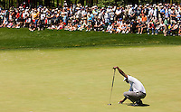 Vijay Singh lines up a putt during the 2007 Wachovia Championships at Quail Hollow Country Club in Charlotte, NC.