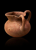 Hittite terra cotta two handled pitcher. Hittite Period, 1600 - 1200 BC.  Hattusa Boğazkale. Çorum Archaeological Museum, Corum, Turkey. Against a black bacground.