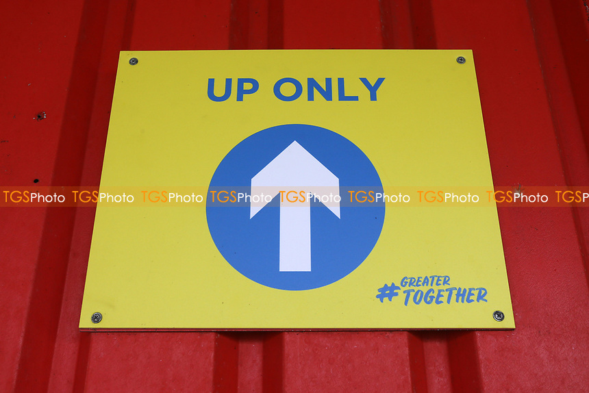 One-way system signage on the terraces during Stevenage vs Swansea City, Emirates FA Cup Football at the Lamex Stadium on 9th January 2021