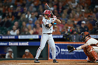 Robert Moore (1) of the Arkansas Razorbacks at bat against the Texas Longhorns in game six of the 2020 Shriners Hospitals for Children College Classic at Minute Maid Park on February 28, 2020 in Houston, Texas. The Longhorns defeated the Razorbacks 8-7. (Brian Westerholt/Four Seam Images)