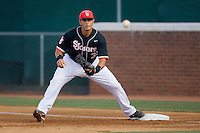 First baseman Paul Karmas #31 of the St. John's Red Storm waits for a throw against the Virginia Cavaliers in the championship game of the Charlottesville Regional at Davenport Field on June 7, 2010, in Charlottesville, Virginia.  The Cavaliers defeated the Red Storm 5-3.  Photo by Brian Westerholt / Four Seam Images